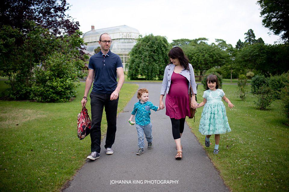 Family of four walking in the botanic gardens in dublin