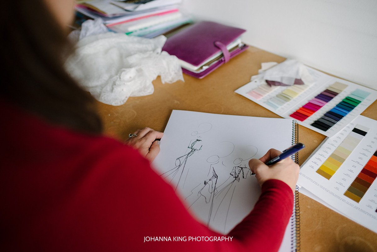 Sarah drawing a bridal bolero on her sketch pad